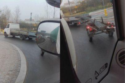 Przeładowany bus z kołami w górze – aż nie mógł przejechać ronda